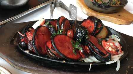 The Tandoori mixed grill on its own hot plate