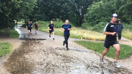 Runners had to negotiate a puddle-strewen course during last Saturday's Wimbledon Common parkrun. Pi