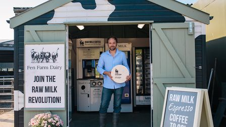 Jonny Crickmore holding his Baron Bigod brie cheese at Fen Farm Dairy of Bungay Picture: KAT MAGER P