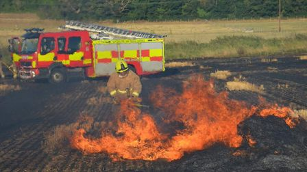 Suffolk Fire and Rescue Service tackling a field fire in Lower Blakenham last summer Picture: SFRS