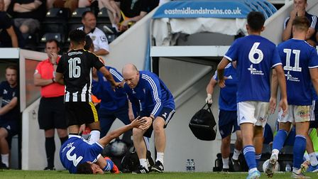 Matt Byard goes to the aid of the injured Tristan Nydam at Meadow Lane Picture Pagepix