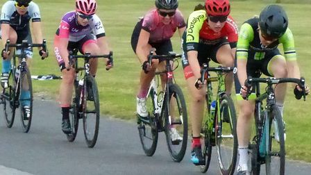 Gemma Melton (far right) and Sophie Holmes head the scratch group in the women's race at Trinity Par