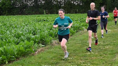 Runners relish a cross country section around the perimter of farm fields at the weekly Thomas Mills