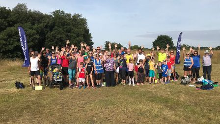 The runners raise their hands for the fifth Great Run Local in Southwold. Picture: COLIN BALDWIN