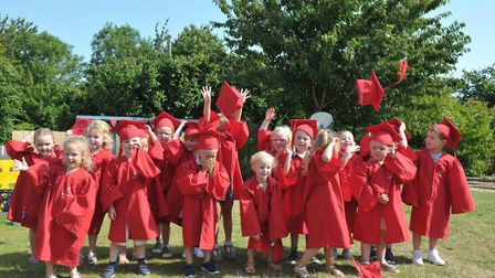 Children throw their hats in the hair as they graduate from nursery, ready for primary school in Sep
