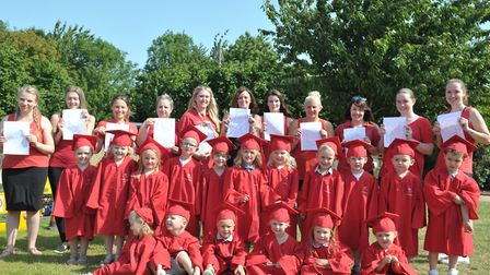 Children and staff at Kidzone celebrate their 'Outstanding' Ofsted report, led by manager Theresa Bu