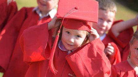 A child adjusts her hat ready for her big moment at nursery graduation Picture: SARAH LUCY BROWN