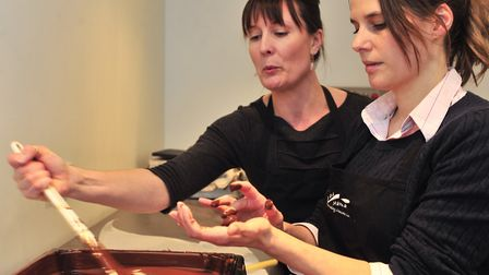 Helen Fraser of Cocoa Mama Chocolaterie of Eye gives Jilly Hurley a lesson in Chocolate making.