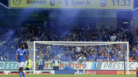 Ipswich fans celebrate after Luke Garbutt's 11th minute deflected shot gave their team the lead at T