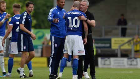 Paul Lambert gives James Norwood a hug at Burton Albion. Picture Pagepix