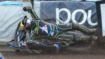 Cameron Heeps slams into the fence after falling in the rerun of heat five. Picture: Steve Waller