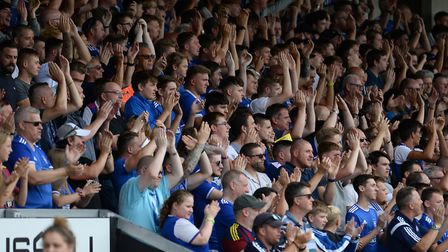Town fans enjoyed the display at Burton, as did Carl. Picture: PAGEPIX