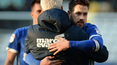 Mick McCarthy gets a hug from his captain Luke Chambers after a win at Preston in 2018. Photo: Pagep