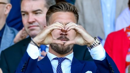 Injured skipper Luke Chambers shows his love to the Ipswich Town fans. Photo: Steve Waller