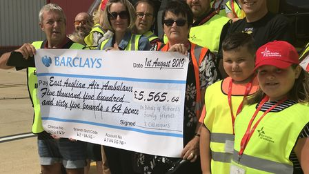 The family of Richard Smith presented the East Anglian Air Ambulance with a cheque of over �5,000 Pi