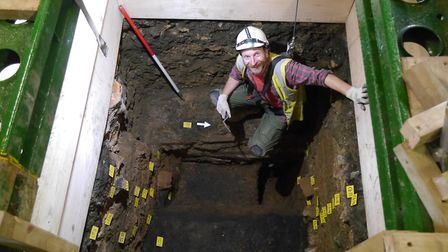 Alec Wade standing on top of a massive foundation (five to seven foot wide) which was part of the Ro