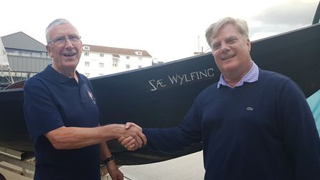 Philip congratulating the donor who donated £4000 to the cause at the event. PICTURE: RACHEL EDGE