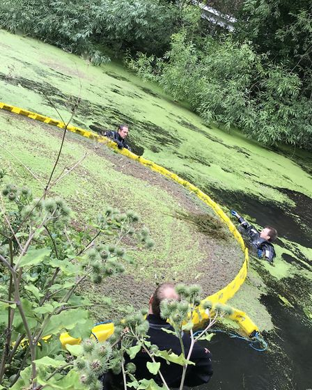 Environment Agency workers setting up equipment to remove weed from River Colne Picture: ENVIRONMENT