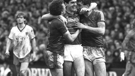 The two goalscorers Mich D'Avray (centre) and Terry Butcher (right) celebrate with team-mate Alan Su