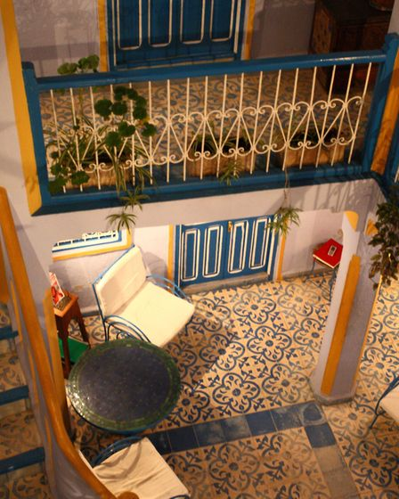 Many Mediterranean homes have tiled floors and internal courtyards to make living more bearable in h