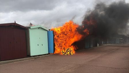 Beach huts on fire on Frinton seafront Picture: IMOGEN AND HENRY KETTERER