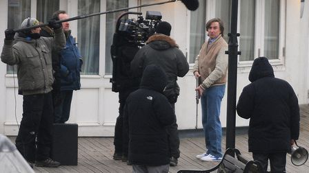 The filming of Alan Partridge: Alpha Papa at Cromer Pier in 2013. Steve Coogan films a scene, holdi
