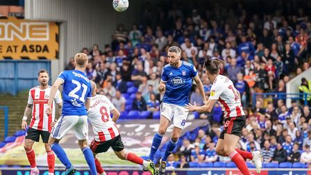 Cole Skuse clears in the first half Picture: STEVE WALLER