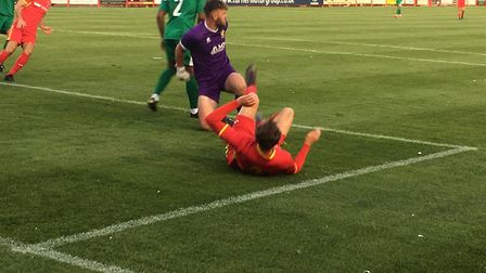 Callum Sturgess takes a tumble, after being denied by keeper Joshua Mollison. But Sturgess did score
