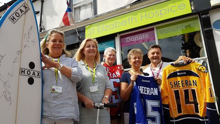 Patrick Otter and his team outside the St Elizabeth Hospice shop in the town, along with some of Ed'