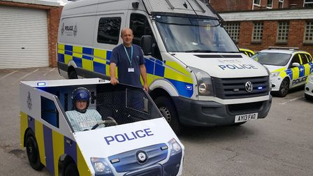 Police Cadet Hannah Crane and her father Mark alongside their soapbox version of a police van. Pictu
