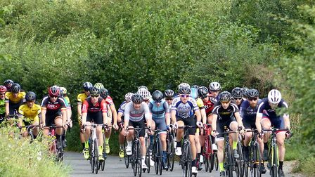 The Mid-Suffolk Road Race bunch at Offton with Andy Proffitt in Ipswich colours, centre. Picture: FE