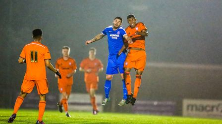 Leiston's Jack Ainsley and Ipswich Town's Corrie Ndaba contest a high ball in last season's Suffolk