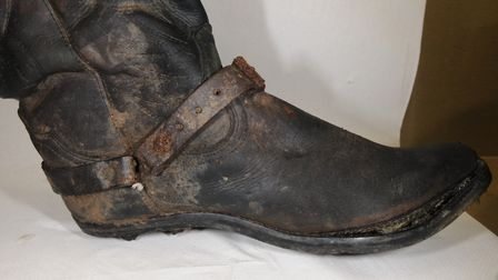 A pair of cowboy boots found with the remains in a scrapyard in St Osyth. Picture: ESSEX POLICE