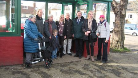 Guests gather to see the opening of a new bus shelter in Wickham Market Picture: BRYAN HALL