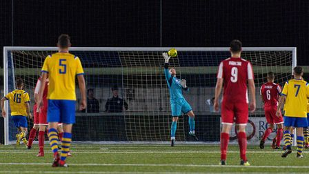 Felixstowe & Walton United's Jack Spurling pulls off one of his many saves, against AFC Sudbury. Pic