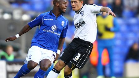 Leroy Lita and Ipswich Town's Aaron Creswell during a Championship match at St Andrews, Birmingham.