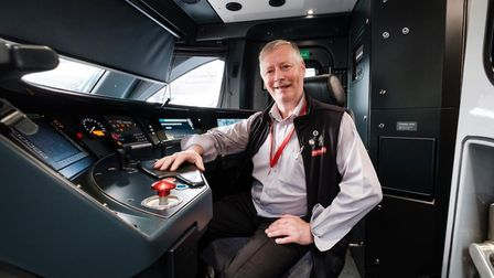 Driver Kevin Murrel inside the cab of the new Stadler train. Picture: GREATER ANGLIA