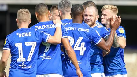 Ipswich players congratulate James Norwood after his penalty had put them into an early 2-0 lead aga