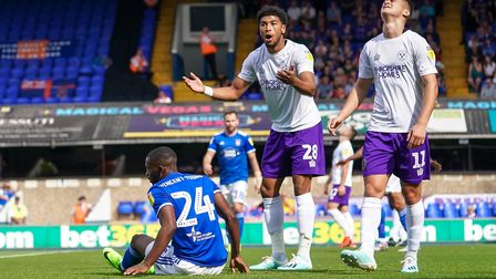 Josh Laurent and Ryan Giles react as Ipswich are awarded an early penalty after Kane Vincent-Young w