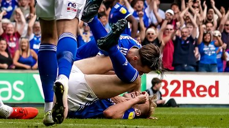 Gwion Edwards congratulates Flynn Downes after he had headed Ipswich's third goal in the 3-0 victory