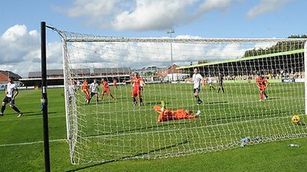 Luke Ingram scores what proved to be the only goal of the game in Needham Market's 1-0 win at Hednes