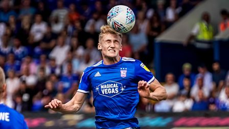 Flynn Downes heads the ball. Picture: STEVE WALLER
