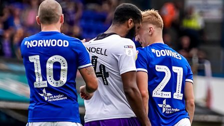 James Norwood drags back Ethan Ebanks-Landell as the Shrewsbury player squares up to Flynn Downes.