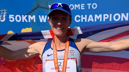 Helen Davies celebrates finishing second at the 50K World Championships, in Brasov, Romania, over th
