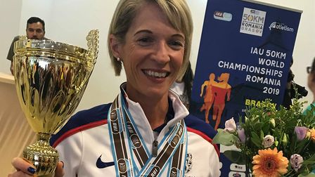 Helen Davies, of Ipswich JAFFA, with her medals and trophy after finishing second at the 50K World C