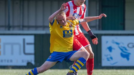 AFC Sudbury's Liam Bennett (yellow) who once again impressed in the 4-3 win over Romford. Picture: T