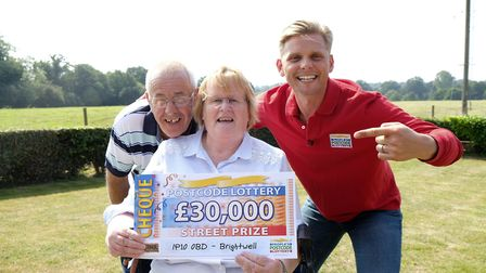 Elaine and David Riches, of Brightwell, receive their prize from People�s Postcode Lottery ambassado