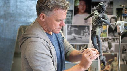 Sean Hedges Quinn working on the maquette of the Kevin Beattie statue. Picture: SARAH LUCY BROWN
