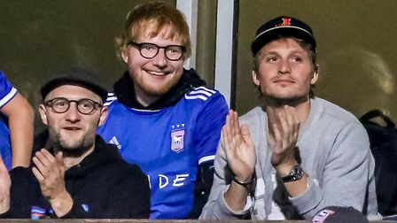 Ed Sheeran watches the Town fans celebrating in the North Stand after James Norwood had levelled the