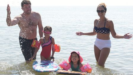 John, Lara, India and Erica Baker cooling off in the sea Picture: SARAH LUCY BROWN